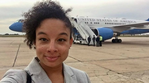 Photo of a young woman, Kristin Smith, standing in front of Air Force One