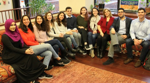 group photo of a students sitting in the main lobby of CCAS