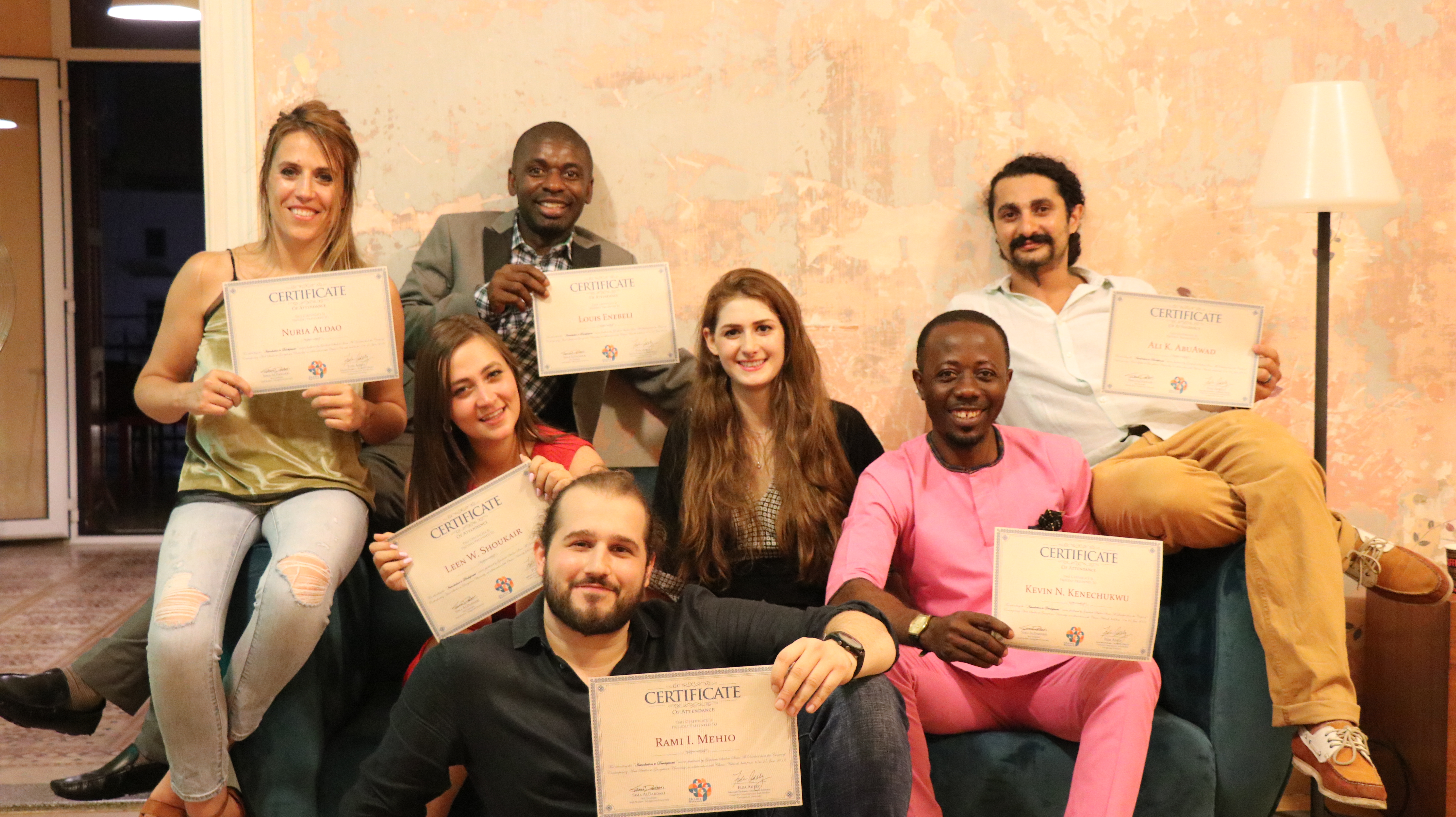 Sima (center) with her students after distributing their course completion certificates. (L to R) Nuria Aldao, Louis Enebeli, Leen Shoukair, Rami Mehio, Kevin Kenechukwu, Ali AbuAwad, and Nour Nahhas (not pictured). Photo Credit: Anthony Zahr, Chams Network