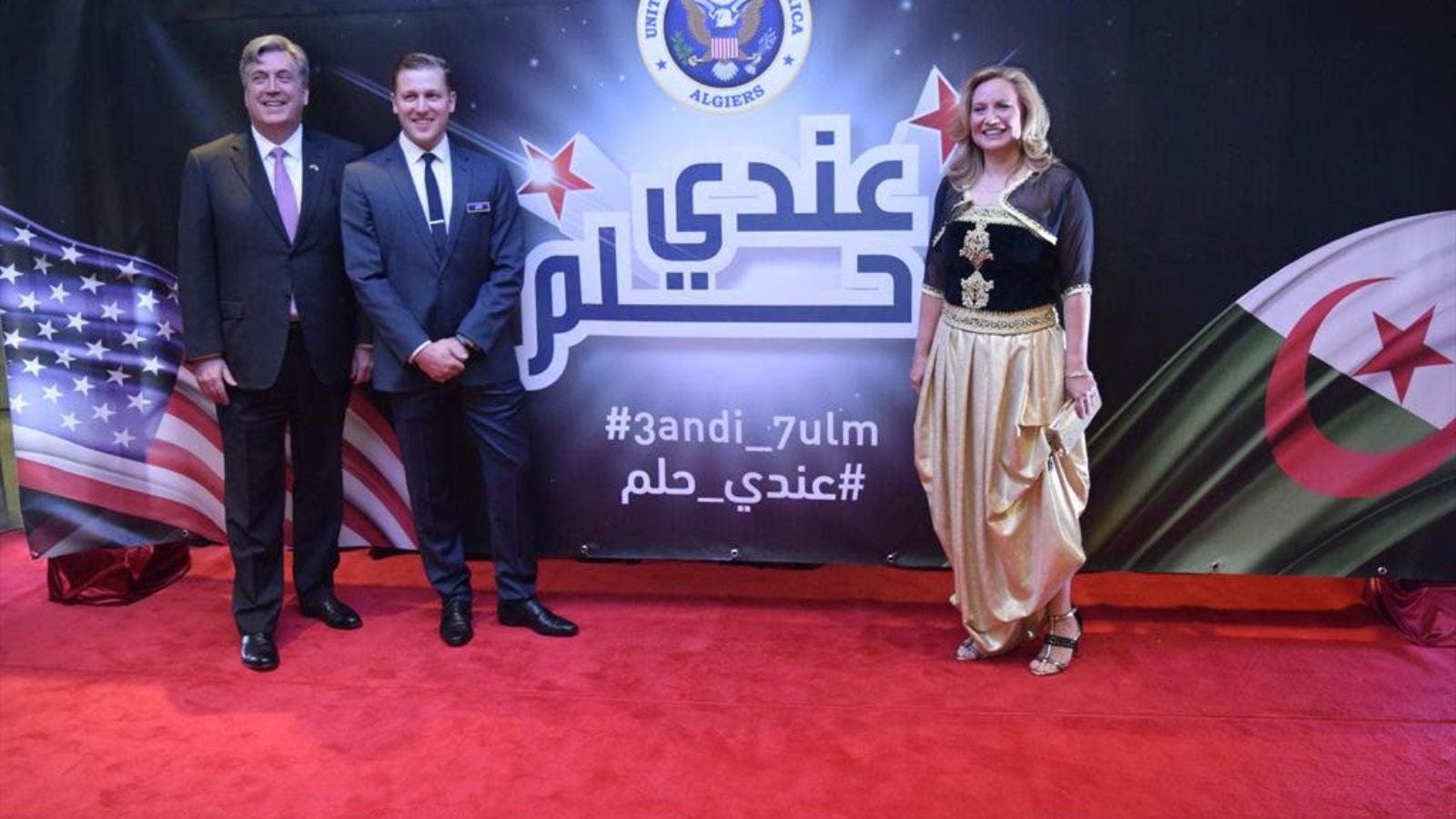 Georgetown alums U.S. Ambassador John P. Desrocher and Andrew Farrand with Karen Rose