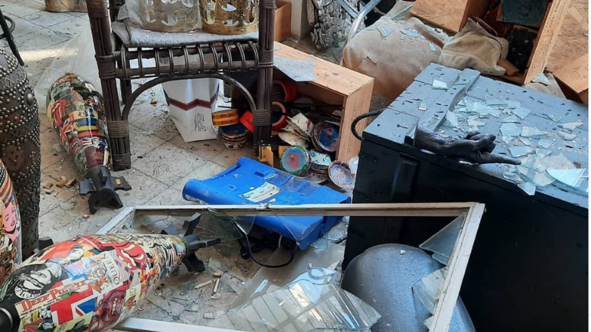 image of an art studio damaged by an explosion